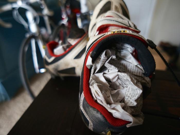 newspaper in wet bike shoes
