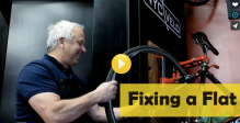 greg lemond fixing a flat